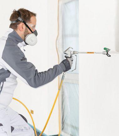 Man using PowerPainter 90 Extra Skid Spraypack - SprayQuip Limited
